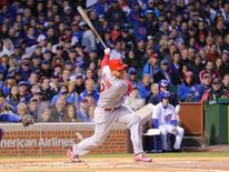 Apr 5, 2015; Chicago, IL, USA; St. Louis Cardinals left fielder Matt Holliday (7) hits an RBI single during the first inning against the Chicago Cubs at Wrigley Field. Dennis Wierzbicki-USA TODAY Sports