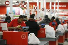 Cashiers check out for Thanksgiving Day shoppers at a Target store in Chicago, November 27, 2014. REUTERS/Andrew Nelles