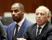 Former National Football League star Darren Sharper (L) and his attorney Leonard Levine appear at the Clara Shortridge Foltz Criminal Justice Center in Los Angeles, California March 23, 2015. REUTERS/Nick Ut/Pool