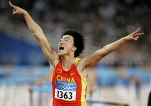 China's Liu Xiang celebrates as he crosses the finish line to win the men's 110 metres hurdle final at the Athens 2004 Olympic Summer Games in this August 27, 2004 file photo. REUTERS/Gary Hershorn