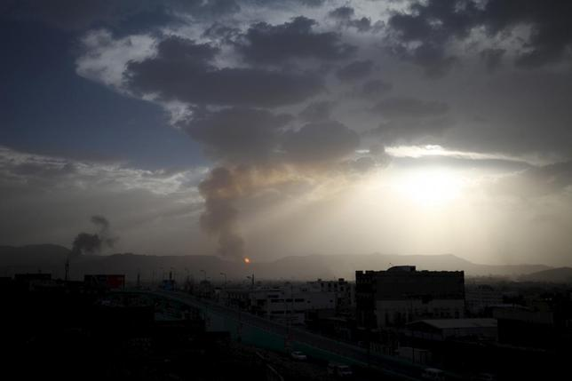 Fire and smoke are seen at a military site after it was hit by an air strike at the Faj Attan mountain of Sanaa April 6, 2015. REUTERS/Mohamed al-Sayaghi