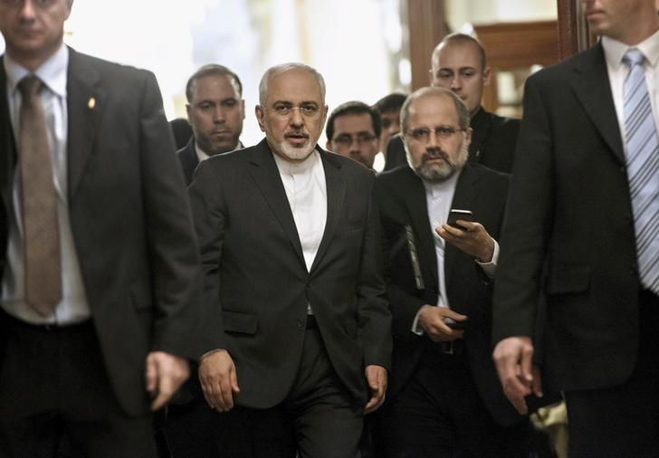 Iranian Foreign Minister Javad Zarif (C) leaves a meeting with U.S. Secretary of State John Kerry and other U.S. officials at the Beau Rivage Palace Hotel March 26, 2015 in Lausanne, Switzerland.   REUTERS/Brendan Smialowski