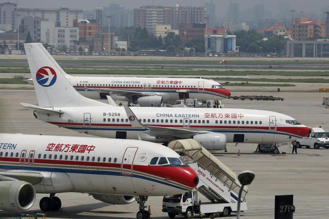 China Eastern Airlines planes are seen on the tarmac at Hongqiao International Airport in Shanghai, in this July 29, 2014 file photo. REUTERS/Aly Song