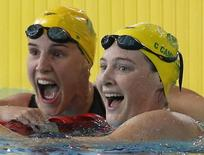Australia's gold medalist Cate Campbell (R) celebrates with silver medalist compatriot Bronte Campbell after the women's 100m Freestyle final at the 2014 Commonwealth Games in Glasgow, Scotland, July 28, 2014. REUTERS/Jim Young