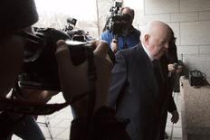 Suspended Senator Mike Duffy arrives at the Ontario Court of Justice, in Ottawa, Canada, April 8, 2015.  REUTERS/Blair Gable