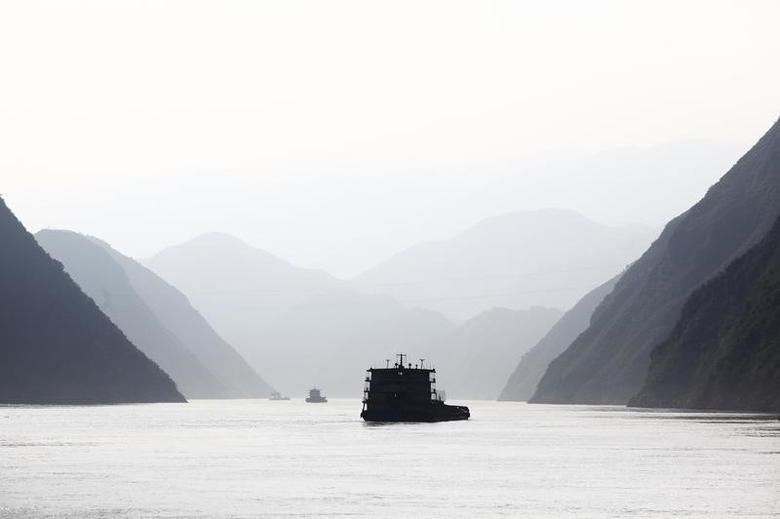 Ships sail on the Yangtze River near Badong, 100km (62 miles) from the Three Gorges dam in Hubei province, August 7, 2012. REUTERS/Carlos Barria