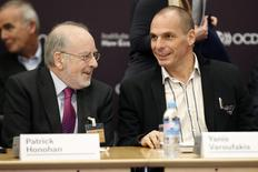 Governor of the Central Bank of Ireland Patrick Honohan (L) and Greek Finance Minister Yanis Varoufakis attend the annual conference of the Institute for New Economic Thinking (INET) at the Organisation for Economic Cooperation and Development (OECD) headquarters in Paris April 9, 2015.   REUTERS/Charles Platiau