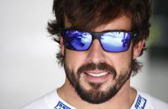 Formula One - F1 - Malaysian Grand Prix 2015 - Sepang International Circuit, Kuala Lumpur, Malaysia - 28/3/15 McLaren's Fernando Alonso in the garage before qualifying Reuters / Olivia Harris