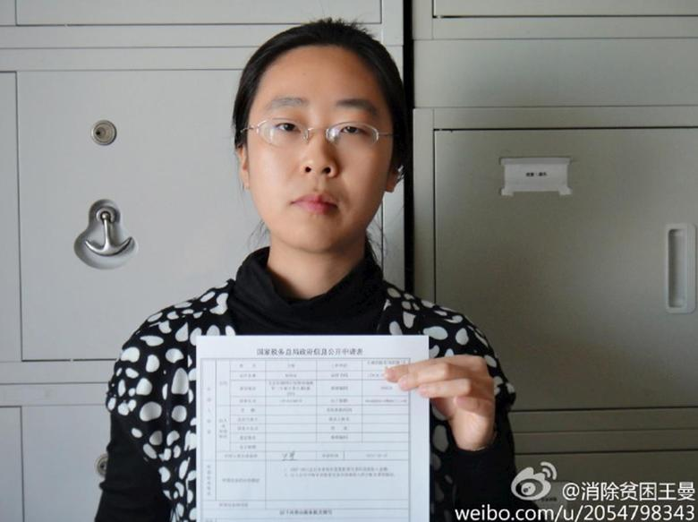Women activist Wang Man, 32, poses with a paper in this undated handout picture taken in an unknown location in China, provided by a women's rights group on April 8, 2015. REUTERS/Handout via Reuters