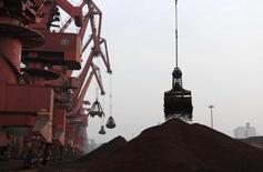 Cranes unload iron ore from a ship at a port in Rizhao, Shandong province February 7, 2015. China's exports declined 3.2 percent year on year to 1.23 trillion yuan (200 billion U.S. dollars) in January, customs data showed on Sunday. Imports stood at 860 billion yuan, down 19.7 percent, according to the data, Xinhua News Agency reported. Picture taken February 7, 2015. REUTERS/China Daily (CHINA - Tags: BUSINESS POLITICS COMMODITIES) CHINA OUT. NO COMMERCIAL OR EDITORIAL SALES IN CHINA