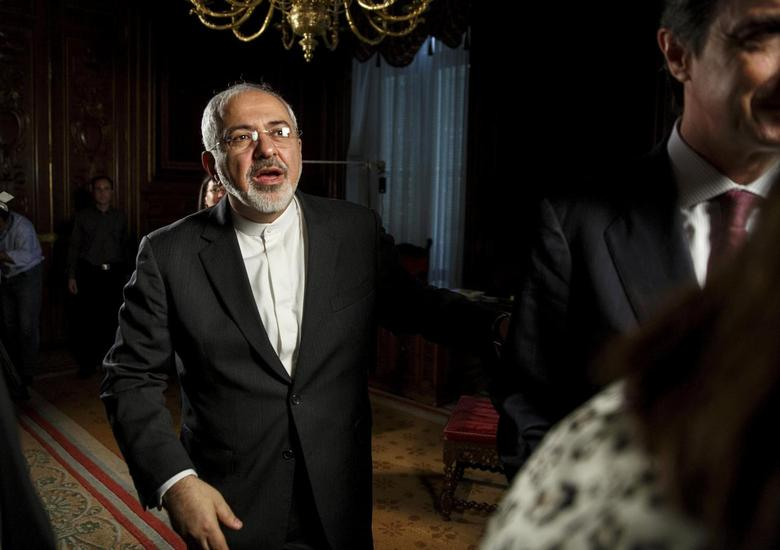 Iranian Foreign Minister Mohammad Javad Zarif reacts after an informal breakfast in Madrid, April 14, 2015. REUTERS/Andrea Comas