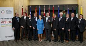 (From L to R) Yukon's Premier Darrell Pasloski, Newfoundland and Labrador's Premier Paul Davis, British Columbia's Parliamentary Secretary for Energy Literacy and the Environment Mike Bernier, New Brunswick's Premier Brian Gallant, Ontario's Premier Kathleen Wynne, Quebec's Premier Philippe Couillard, Nova Scotia's Minister of Environment Randy Delorey, Manitoba's Premier Greg Silinger, Saskatchewan's Premier Brad Wall, Northwest Territories' Premier Bob McLeod and Nunavut's Premier Peter Taptuna pose for a family photo during the Quebec Summit On Climate Changes at the Hilton hotel in Quebec City, April 14, 2015. REUTERS/Mathieu Belanger