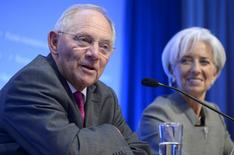 Germany's Finance Minister Wolfgang Schaeuble (L) makes remarks as IMF Managing Director Christine Lagarde listens during a discussion of Catastrophe Containment and Relief Trust, at the IMF and World Bank's 2015 Annual Spring Meetings, in Washington, April 16, 2015.         REUTERS/Mike Theiler