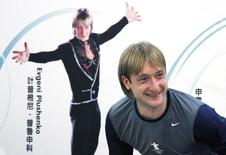 Former Olympic champion figure skater Yevgeny Plushenko of Russia smiles as he leaves a news conference in Beijing September 3, 2010.  REUTERS/David Gray