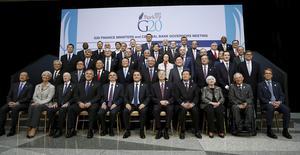 Autoridades posam para foto durante reuniões em Washington.   REUTERS/Gary Cameron