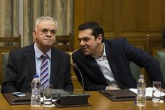 Greek Prime Minister Alexis Tsipras (R) talks to Deputy Prime Minister Yannis Dragasakis during the first meeting of new cabinet post elections in the parliament building in Athens in this file photo taken on January 28, 2015. REUTERS/Marko Djurica