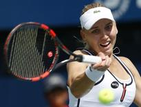 Russian's Elena Vesnina returns to China's Peng Shuai during their women's singles tennis match at the WTA Dubai Tennis Championships, in this file photo taken on February 16, 2015.  REUTERS/Ahmed Jadallah
