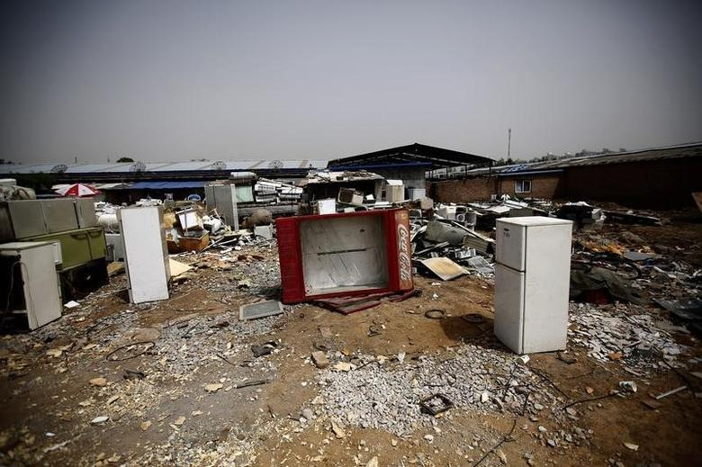 Broken fridges are seen in the yard of a recycling workers' tenement house in Dongxiaokou village in Beijing, May 15, 2014. REUTERS/Kim Kyung-Hoon