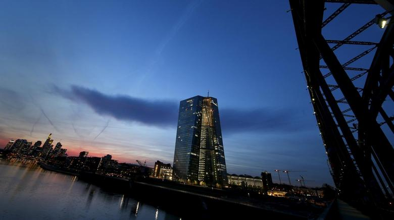 The famous skyline with its banking district (L) and the new headquarter of the European Central Bank (ECB, C) is pictured in Frankfurt early evening April 13, 2015. REUTERS/Kai Pfaffenbach