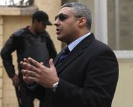 Al Jazeera journalist Mohamed Fahmy is seen outside of a court before a hearing in his trial in Cairo, February 23, 2015. REUTERS/Asmaa Waguih