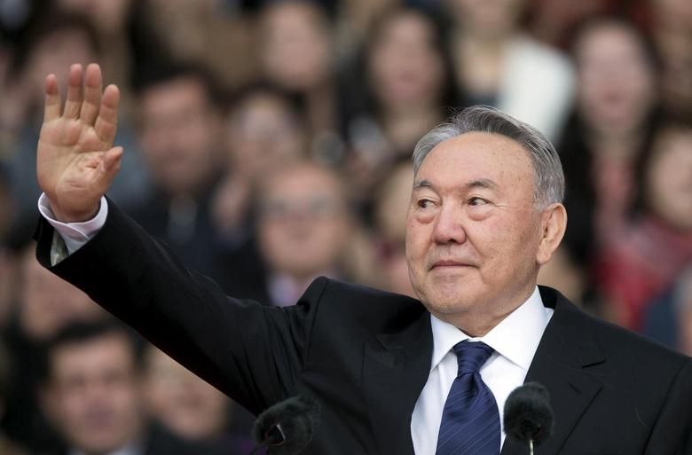 Kazakhstan's President and presidential candidate Nursultan Nazarbayev waves to audience during an election campaign rally at a stadium in Almaty April 18, 2015.   REUTERS/Shamil Zhumatov