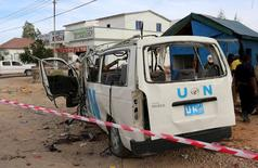 A U.N. van is seen damaged by an improvised explosive device (IED) outside the U.N. compound in Garowe, the administrative capital of Somalia's semi-autonomous Puntland, April 20, 2015.  REUTERS/Feisal Omar
