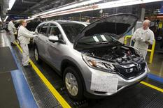 Production Associates inspect cars moving along assembly line at Honda manufacturing plant in Alliston, Ontario March 30, 2015.  REUTERS/Fred Thornhill