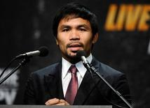 Mar 11, 2015; Los Angeles, CA, USA; Manny Pacquiao during a press conference to announce his fight with Floyd Mayweather fight on May 2, 2015 at Los Angeles. Mandatory Credit: Robert Hanashiro-USA TODAY Sports