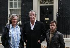 James May (L), Jeremy Clarkson (C) and Richard Hammond pose outside 10 Downing Street in London in this file photo taken on November 29, 2011. REUTERS/Suzanne Plunkett