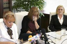 (L-R) Autumn Burns, Janice Baker Kinney, and Marcella Tate attend a news conference announcing more allegations against comedian Bill Cosby in Los Angeles, California April 23, 2015. REUTERS/Jonathan Alcorn