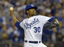 Kansas City Royals starting pitcher Yordano Ventura throws a pitch against the San Francisco Giants in the first inning during game six of the 2014 World Series at Kauffman Stadium. Mandatory Credit: Denny Medley-USA TODAY Sports