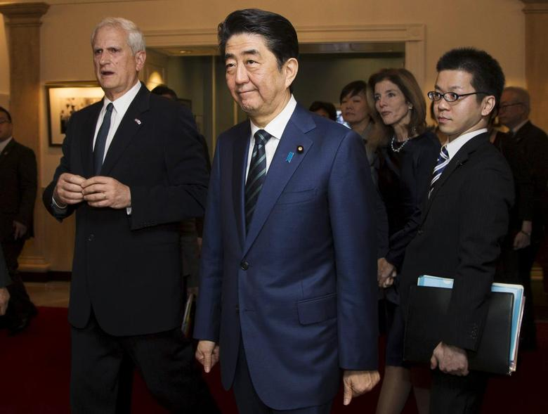 Japanese Prime Minister Shinzo Abe (C) tours the John F. Kennedy Presidential Library with U.S. Ambassador to Japan Caroline Kennedy Schlossberg (2nd R) and her husband Edwin Schlossberg (L) in Boston, Massachusetts April 26, 2015.  REUTERS/Brian Snyder