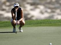 Carin Koch of Sweden lines up her shot on the 8th hole during the first round of the Dubai Ladies Masters December 10, 2014.  REUTERS/Caren Firouz