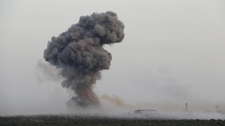 Smoke rises from Qarmeed camp after Islamist rebel fighters said a suicide bomber from al Qaeda's Nusra Front drove a truck packed with explosives into the compound and blew it up, in northwestern Idlib province, Syria April 26, 2015. REUTERS/Ammar Abdullah