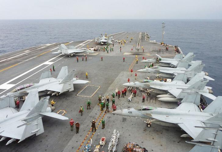 U.S. Navy FA-18 Hornets park on the flight deck of the USS George Washington during the Annual Exercise 2013, at sea November 28, 2013. REUTERS/Kyodo