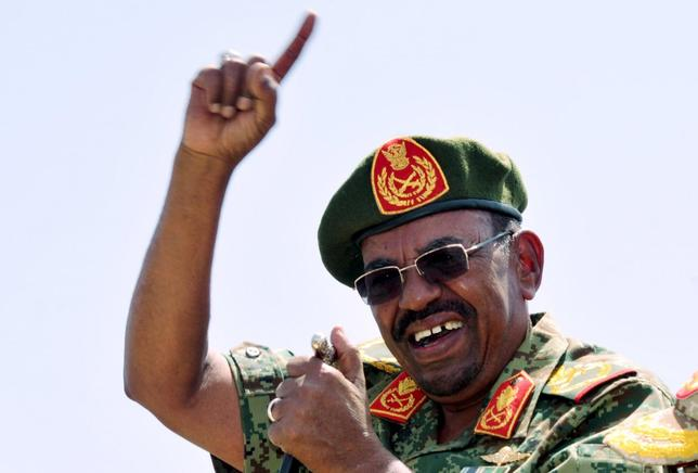 Sudanese President Omar Hassan al-Bashir gestures as he leads victory celebrations after the Sudanese Armed Forces (SAF) and the Rapid Support Forces (RSF) defeated the Justice and Equality Movement (JEM) rebels during his visit to the battle area of Gouz Dango in South Darfur April 28, 2015. REUTERS/Stringer