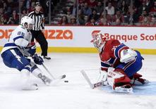 May 1, 2015; Montreal, Quebec, CAN;  Montreal Canadiens goalie Carey Price (31) makes a save against Tampa Bay Lightning forward Nikita Kucherov (86) during the overtime period in game two of the second round of the 2015 Stanley Cup Playoffs at the Bell Centre. Mandatory Credit: Eric Bolte-USA TODAY Sports