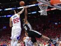 May 2, 2015; Los Angeles, CA, USA; Los Angeles Clippers forward Matt Barnes (22) blocks a shot by San Antonio Spurs forward Kawhi Leonard (2) at the buzzer in game seven of the first round of the NBA Playoffs at Staples Center. Clippers won 111-109. Mandatory Credit: Jayne Kamin-Oncea-USA TODAY Sports