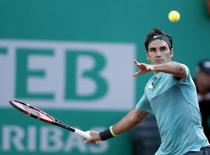 Roger Federer of Switzerland hits a return to Uruguay's Pablo Cuevas during their ATP World Tour Istanbul tennis tournament singles final tennis match in Istanbul, Turkey May 3, 2015.  REUTERS/Osman Orsal
