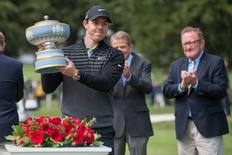 May 3, 2015; San Francisco, CA, USA; Rory McIlroy poses for photos with the Walter Hagen trophy after winning the final round of the World Golf Championships-Cadillac Match Play at TPC Harding Park. Mandatory Credit: Ed Szczepanski-USA TODAY Sports