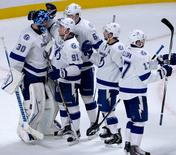 Tampa Bay Lightning players including goalie Ben Bishop (30) and Steven Stamkos (91) celebrate their victory against the Montreal Canadiens in game two of the second round of the 2015 Stanley Cup Playoffs at the Bell Centre. Mandatory Credit: Eric Bolte-USA TODAY Sports