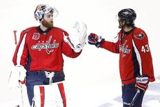 Washington Capitals goalie Braden Holtby (70) and Capitals right wing Tom Wilson (43) celebrate after their game against the New York Rangers in game three of the second round of the 2015 Stanley Cup Playoffs at Verizon Center. Mandatory Credit: Geoff Burke-USA TODAY Sports