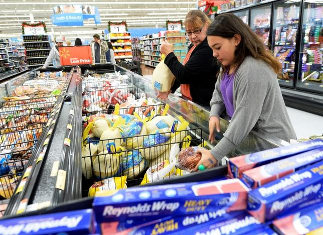 Tina Corpus and her daughter Christina shop for turkey at a Walmart store in the Porter Ranch section of Los Angeles November 26, 2013. REUTERS/Kevork Djansezian