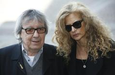 Former Rolling Stone Bill Wyman arrives with wife Suzanne Accosta for a memorial service for the broadcaster David Frost at Westminster Abbey in London March 13, 2014.  REUTERS/Luke MacGregor