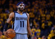 Memphis Grizzlies guard Mike Conley (11) prepares to shoot a free throw during the fourth quarter in game two of the second round of the NBA Playoffs against the Golden State Warriors at Oracle Arena. The Grizzlies defeated the Warriors 97-90. Mandatory Credit: Kyle Terada-USA TODAY Sports