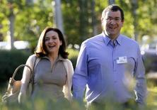 File photo of Sheryl Sandberg, Chief Operating Officer (COO) of Facebook, with her husband David Goldberg, CEO of SurveyMonkey at a media conference in Sun Valley, Idaho July 9, 2014. REUTERS/Rick Wilking
