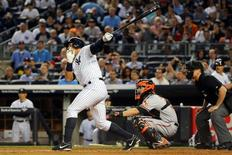 May 7, 2015; Bronx, NY, USA;  New York Yankees designated hitter Alex Rodriguez (13) hits his 661 home run surpassing the record of Willie Mays during the third inning against the Baltimore Orioles at Yankee Stadium. Mandatory Credit: Anthony Gruppuso-USA TODAY Sports