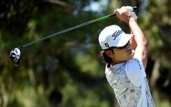 May 8, 2015; Ponte Vedra Beach, FL, USA; Kevin Na hits his tee shot on the 9th hole during the second round of The Players Championship golf tournament at TPC Sawgrass - Stadium Course. Mandatory Credit: John David Mercer-USA TODAY Sports