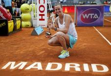 Czech Republic's Petra Kvitova poses with her trophy after winning her final match against Svetlana Kuznetsova of Russia at the Madrid Open tennis tournament in Madrid, Spain, May 9, 2015. REUTERS/Andrea Comas