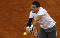 Canada's Milos Raonic returns a backhand to Britain's Andy Murray during their quarterfinal match at the Madrid Open tennis tournament in Madrid, Spain, May 8, 2015. REUTERS/Sergio Perez